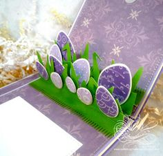 handmade Easter card ... pop-up card format ... eggs in grass ... pretty in purple ... luv it!