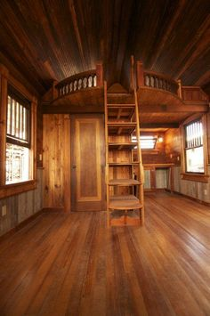 extended round loft... wood all'round... entry to the left of picture frame... bathroom with tub behind door ~ canyon lake tiny house - texastinyhouses ... designed and built with 99% pure salvage