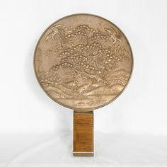 Mirror antique Japanese bronce. The surface of one side completely smooth , so as to be mirrored . The other side is richly decorated with a landscape scene that includes trees , turtles and storks, all with a special meaning in Japanese symbolism year:1770.  Price: € 620.  For more information: info@antiquariatoannadonati.com