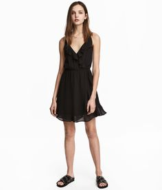 Check this out! Dress in airy woven fabric with flounce details. V-neck, narrow shoulder straps, and attached wrapover front section. Elasticized seam at waist and gently flared skirt. Lined. - Visit hm.com to see more.