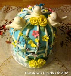 Super cute love birds and their cage from Fantabulous Cupcakes