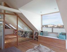 Fantastic loft conversion - love the light-frame window and sliding glas partitions