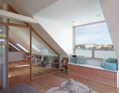 Fantastic loft conversion - love the light-frame window and sliding glas partitions