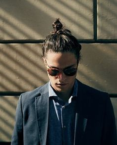 - a man bun. There are a lot of variations you can have in a man bun. Some of the man bun hairstyles are mentioned below. Make sure you have a look at beautiful examples of man bun hairstyles at the end. Miles Mcmillan, Hair And Beard Styles, Short Hair Styles, Top Knot Men, Chignon Simple, Man Bun Hairstyles, Men's Grooming, Stylish Men, Beautiful Men