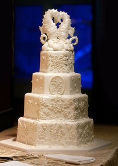 Ana Parzych Custom Cakes Hexagon tiers embellished with fondant appliques. Featuring a gum paste monogram plaque with fondant molded pearl border and a sculpted fondant Seahorse topper and shells. Beach Wedding Cake Toppers, Wedding Shower Cakes, Fondant Wedding Cakes, Seahorse Wedding, Seashell Wedding, Amazing Wedding Cakes, White Wedding Cakes, Wedding Venues Beach, Wedding Day
