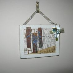 Flowers in Tune Materials Used: preloved jewellery, sheet music, waterpainted crackled paper, acrylic paints, waterpaints, soft mesh, tacks, gel medium. Measures: 9.5cm x 8cm COST: $6 each or 3 mini plaques for $15 https://www.rawroughrecycled.com https://www.facebook.com/RawRoughRecycled