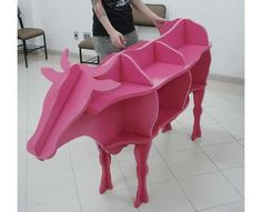 """Cow-Shaped Shelves - You don't have to ask """"Where's the beef?"""" with this cow-shaped design called 'Estante Vaco' by Estúdio A. Creative Bookshelves, Pink Cow, Unusual Furniture, Home Libraries, Shelf Design, Creative Home, Wood Projects, Pop Up Stores, Furniture Design"""