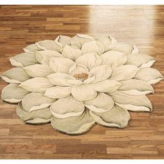 "$160- $1000 - Melanie Magnolia Round Flower Rug - Shaped like a magnolia in full bloom, the Melanie Round Flower Rugs are handcrafted and handcarved of 100% wool. Hand-tufted floorcoverings in hues of moonlight, whisper white, and double cream have a realistic floral look. Round rugs are 5/8"" thick. We recommend professional cleaning by a rug cleaner. Made in China.  • Handcrafted and handcarved  • Made of pure wool • Elegant floral area rugs • Edges follow the flower shape"