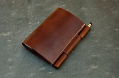 """Custom Leather No. 100 Field Notes Cover by TheRailroadLeatherCo - Any notebook will do, but if you want to be looked upon as a serious photographer, little things will set you apart from those who don't """"look"""" as invested in their craft as you do. Leather Book Covers, Leather Books, Leather Cover, Leather Notebook, Leather Journal, Leather Holster, Leather Bag, Leather Factory, Embellished Shoes"""