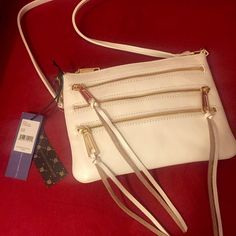 NWT Rebecca Minkoff 3 Zip Rocker crossbody Gorgeous Rebecca Minkoff 3 Zip Rocker crossbody bag in white with gold zippers. There is a very slight smudge above the top zipper as shown in the last photo, but it is not noticeable and is in otherwise brand new, perfect condition. Price is negotiable, but please keep it reasonable :) Rebecca Minkoff Bags Crossbody Bags