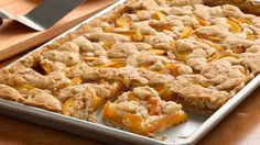 Peach Slab Pie  [][] this recipe uses pre-fab pie crust and a tube of sugar cookie dough, but there's nothing stopping us from using the real stuff.