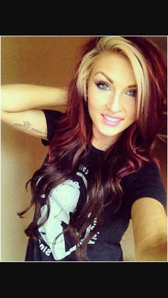 Dark brown bottom section and burgundy mid section hair color with blonde bangs.