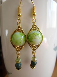 Gold wiire wrapped earrings with green beads.dangle earrings.simple and gorgeous.