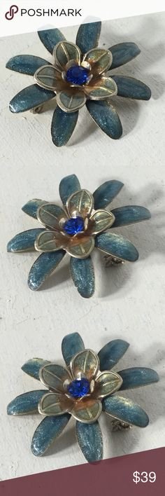 "Vintage Rhinestone Shimmer Color Flower Brooch Fashion/Costume Brooch. Metal/Stone Unknown. Years of purchased jewelry which has a history that I am unaware of so if you have allergies, keep that in mind. Always clean purchased jewelry.  Please ask all questions before purchasing. Good Condition - fading/discoloration of metal. Sold ""As Is"".  Shows wear which is consistent with its age. Please remember, the pictures are your description, too, so please look at all of them. Sparkles & Happy…"