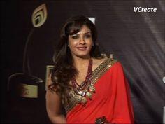Raveena Tandon looking lovely in red saree at Golden Petal Awards 2012.