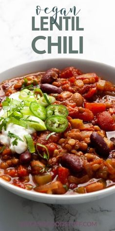 This vegan lentil chili is easy, hearty and so delicious you won't even miss the meat! Full of flavour and nutrients this chili is perfect for busy nights - just throw everything in a pot and cook! Chilli Recipes, Lentil Recipes, Seafood Recipes, Soup Recipes, Cooking Recipes, Good Healthy Recipes, Delicious Vegan Recipes, Whole Food Recipes, Vegetarian Recipes