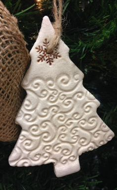 Rustic Salt Dough Christmas Tree Ornament with simple swirl imprint. Hand-stamped salt dough tree ornament, Ivory color with stamped snowflake at top. Each tree measures x Twine hanger. Recommended for indoor use only. Ornaments have a clear c Salt Dough Christmas Ornaments, Polymer Clay Christmas, Clay Ornaments, Christmas Ornaments To Make, Handmade Christmas, Homemade Ornaments, Etsy Christmas, Felt Christmas, Christmas Ideas