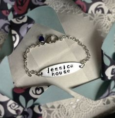 The JESSICA HOUSE bracelet is a hand-stamped original creation by The HANDMAID Workshop. The money from the sale of these bracelets goes to