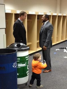 Peyton congratulating Ray Lewis after Bronco loss.  Class act!  AND love lil' Marshall Manning playing in the foreground.