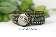 Indian Agate 3 Row Beaded Leather Bracelet Cuff  This rustic green bracelet is handmade with an earthy collection of gemstone and glass beads, hand stitched onto genuine Brown leather. A stacked look with one easy to fasten bracelet. - Indian Agate gemstone beads, a mix of natural