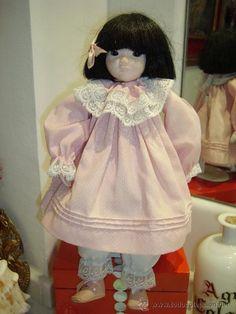 Ancient oriental porcelain doll