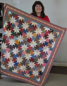 """Linda Wirtz of Roswell, GA places cream stars on a colorful pieced """"ground"""", in an interesting role-reversal of colors. --Just Judie contest 2013"""
