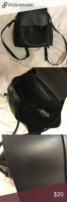 "Black Detailed Drawstring Backpack This bag is still available on Zara's site but in white and pink (what I currently see as of April 27, 2017). This bag was only used a few times. There are 2 spots of slight discoloration (picture#4 and picture#5). You can't really see it unless you look at it close up. Comes with side pockets with zippers and interior pocket but no zipper. It's a drawstring and magnetic clasp top closure. Dimensions: 11.4""H x 9.8""W x 5.5""D Zara Bags Backpacks"