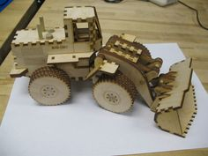 Laser Cut Front End Loader Toy includes exploded view of the bucket asembly
