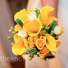 calla lilies, spray roses, green hypericum berries and loops of lily grass.