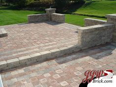 wavy lay brick patio with inset fire pit and sitting walls ... - Brick And Stone Patio Ideas