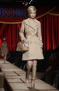 Tan-tastic! Clad in a beige trench coat, the garment cinched in at her tiny waist with a thick belt, and was adorned in shipping labels, putting a quirky twist on an undeniable classic