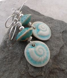 Gorgeous conch charms, expertly handcrafted in stoneware clay by Tina Francis, team up with rustic clay bicones (handcrafted by Jana Bližňáková ) for