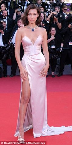 Glam girls: It is no wonder Bella Hadid, Emily Ratajkowski and Lily-Rose Depp (L-R) pulled out all the stops in matching champagne show-stopping gowns, as they paraded the red carpet of the 70th Cannes Film Festival's Opening Gala