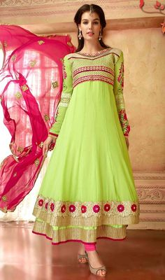 Look amazing draped in this mint green color georgette embroidered layered Anarkali suit. This lovely attire is showing some brilliant embroidery done with stones, lace and resham work. #onlineanarkalicollection #gorgeousdesignanarkalisuits #churidaranarkalidress