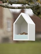 Sophie Conran Bird Feeding House....  Encourage lots of birds to visit your garden, hopefully they will scoop up a few tasty slugs on their travels! Fill the tray with bird seed or nuts and then just hang it up so the opening faces away from the prevailing wind to keep the food dry. Made from FSC wood. 26cm high x 16cm wide x 16cm deep