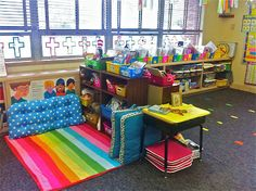 See the long blue cushion on the rug? It's a bench cushion. Perfect for lining the wall of a reading corner!