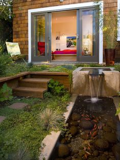 Great Idea!  Lower the backyard and build an upper deck.  Maybe even dig a small swimming pool?!  Oh, and the sliding doors!  Turning the whole back wall into sliding doors ;expand the back porch!