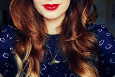 red lips and auburn hair