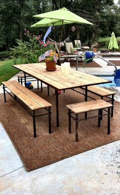 Outdoor dining table and benches big enough to fit plenty of people while entertaining in the summer