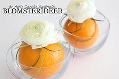 Anderledes konfirmation med orange som grundfarve. Se videoen på bloggen - http://www.blomsterideer.dk/blomsterideer-uge-15-konfirmation-pa-en-anderledes-made/