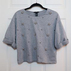 "H&M Embellished Boxy Top Heather gray beaded embroidery H&M sweatshirt boxy top. Size XS. Like new condition. Beads and jewels are all still in tact. Approx 20"" across chest and 19.5"" in length. 86% cotton / 14% Viscose. Sorry NO TRADES and NO PAYPAL TRANSACTIONS. NO EXCEPTIONS. Bundle for additional discount and to save on shipping! H&M Tops Tees - Short Sleeve"