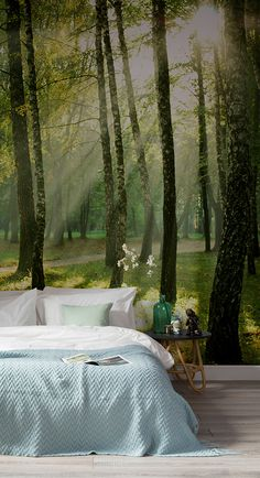 Let the sun in on your room with a peaceful forest wallpaper to brighten up each day. The lush green hues and soft yellow sunlight shining through this wallpaper mural can transform any room into a calming getaway. Pairs perfectly with wood decor accents and neutral tones.