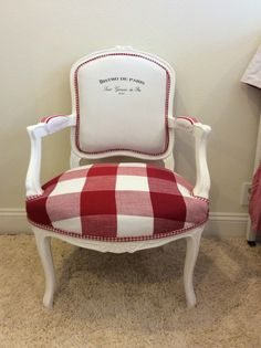 Reupholstered French chair. Gingham on the seat and a kitchen towel on the backrest.