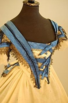 61: A cream challis ball gown circa 1863, the bodice an - 3
