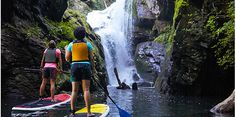 Paddleboarders make their way to the breathtaking Laurel Fork Falls at Lake Jocassee.