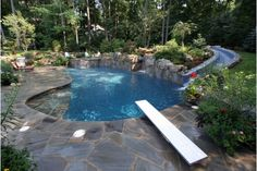 This Pool Is Very Fun  You Dont Have To Have Some Fancy Pool To Make It  Fun, These Homeowners Just Added A Diving Board And A Waterslide, With In  My Opinion ...