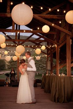 White paper lanterns, white string lights. (Style Me Pretty - Photos By Erin Kate Photography - http://www.stylemepretty.com/gallery/picture/783014)