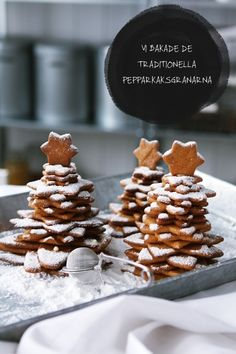"""Xmas Tree Cookie towers.. so cute! The heading is Swedish for """"We baked the traditional gingerbread trees""""  These are gingersnaps. A GOOD RECIPE IS HERE: http://www.tastebook.com/recipes/661705-Pepparkakor-Swedish-Gingerbread-"""