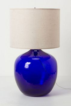 TARDIS blue. But the shape is too cumbersome. I wonder if I could make my own lamp base. Hmmm.