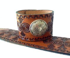 Beautiful tooling and a Celtic concho complete this gorgeous cuff.